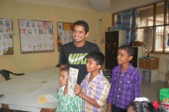 311 - Indian Tennis star Sanam Singh interacting with playroom kids